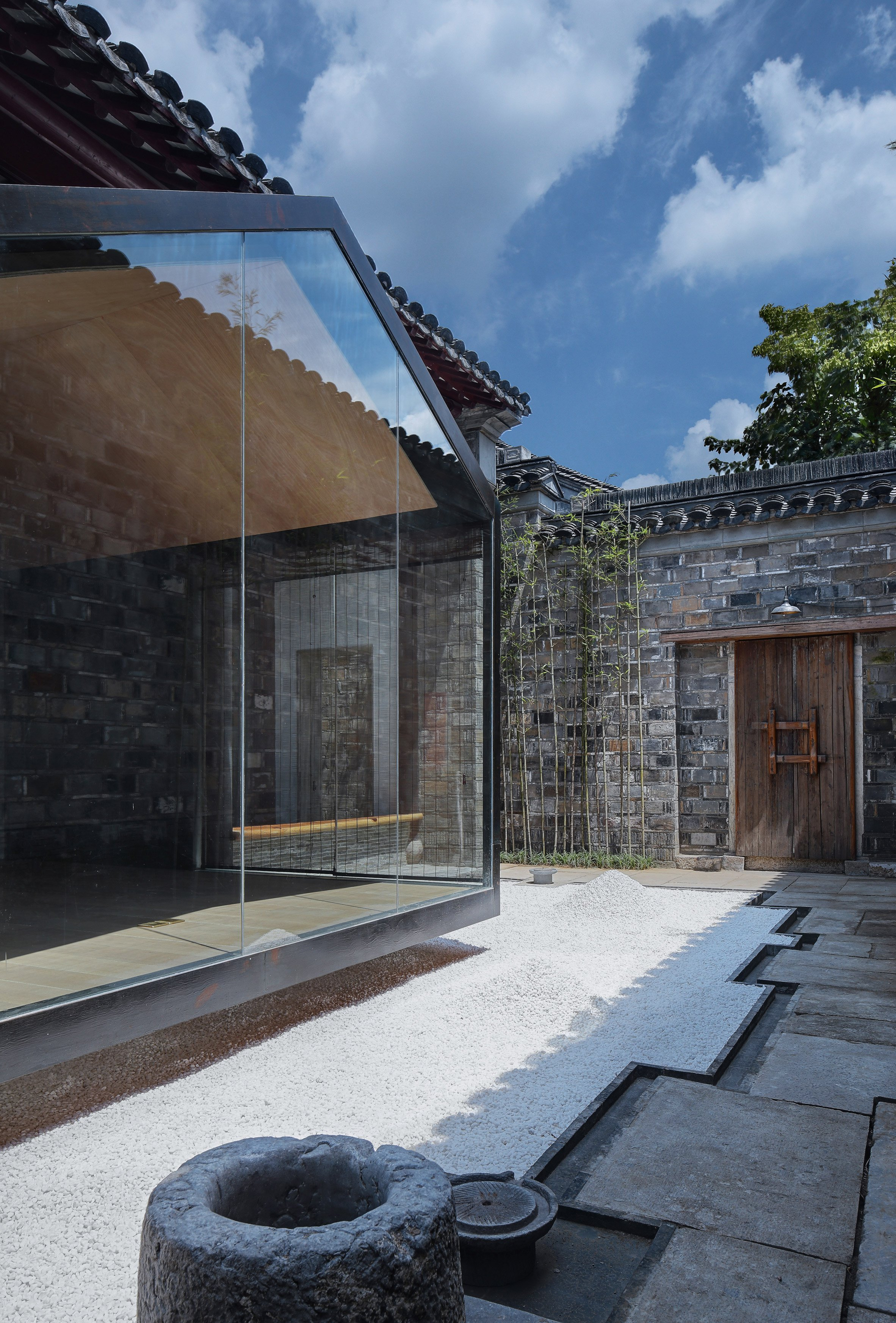 Glazed meditation room overlooks traditional courtyard from Nanjing home