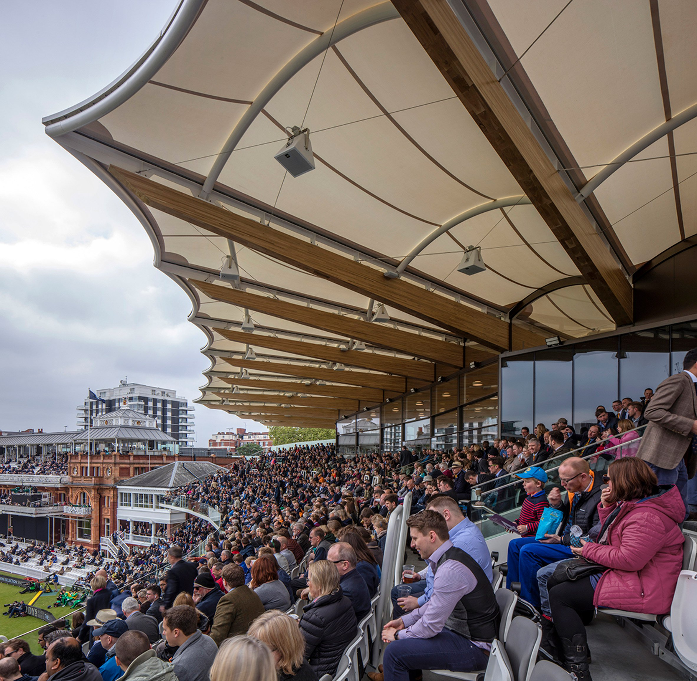 Populous updates Lord's cricket stand with fan-shaped roof