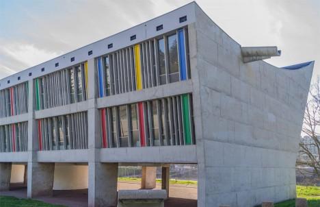 Maison de la Culture by Le Corbusier features an asymmetrically curved concrete roof