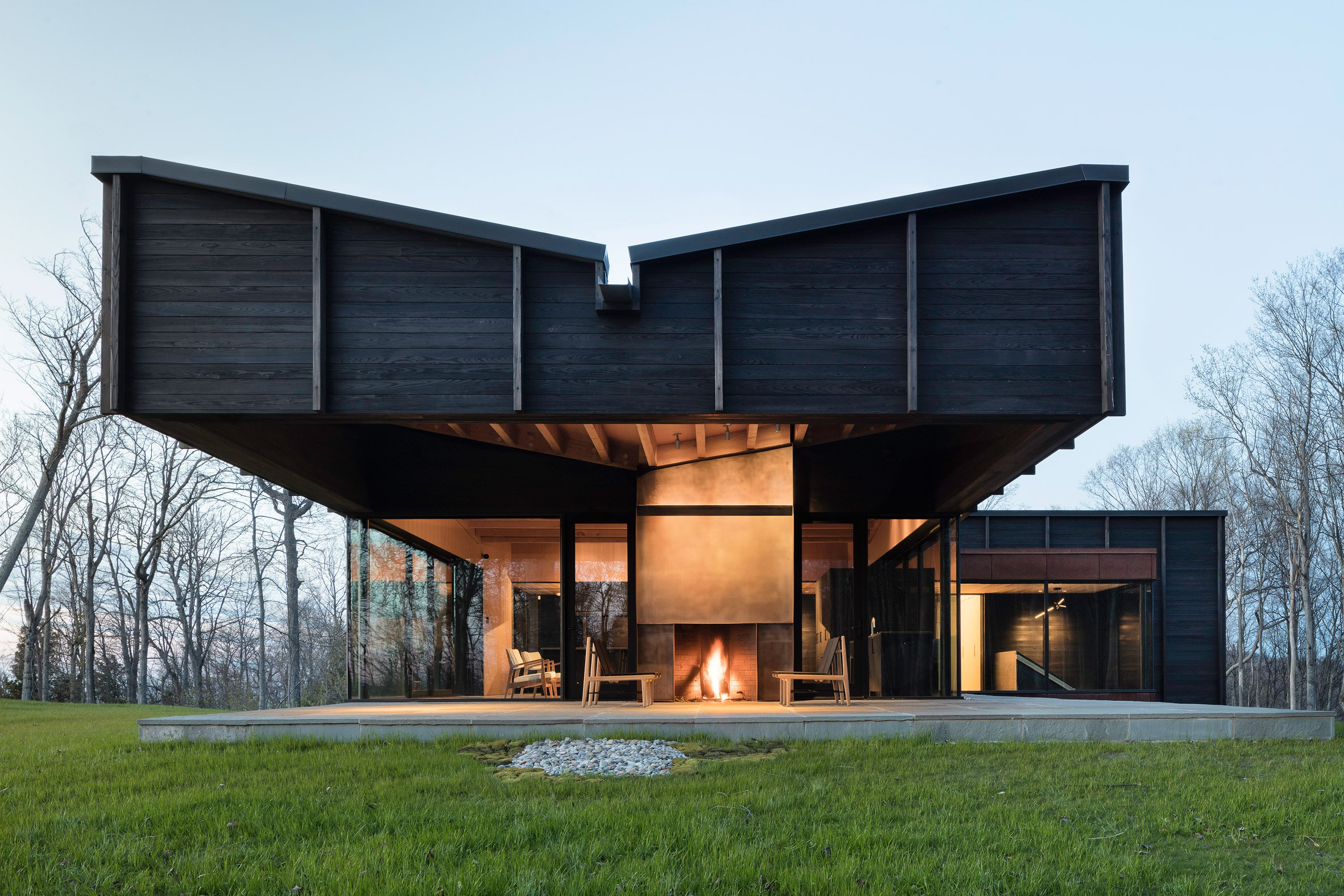 Desai Chia's Michigan Lake House features a roof that cantilevers over a patio