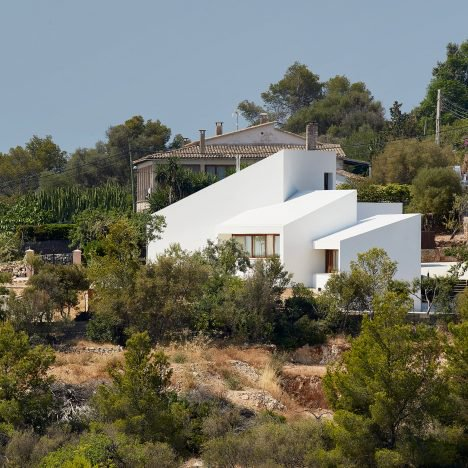 Four angular white volumes form house in Mallorca by Oliver Hernaiz Architecture Lab