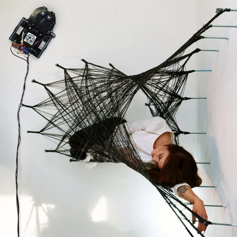 """Wall-climbing mini robots build """"entirely new structures"""" from carbon fibre"""