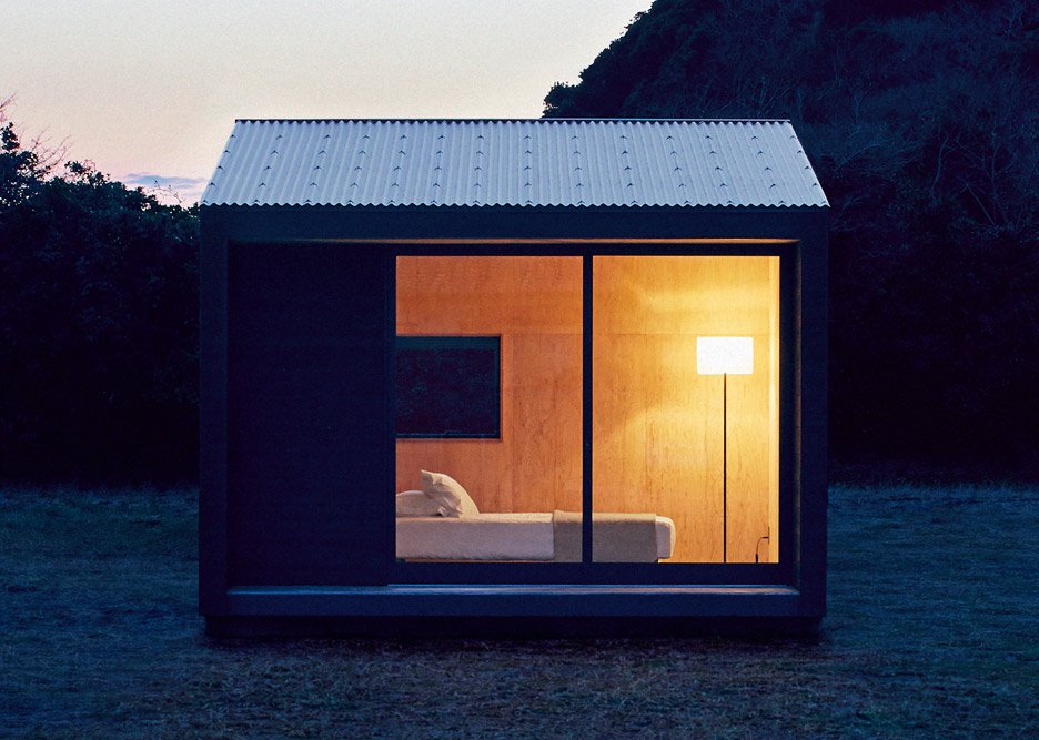 Muji to sell tiny blackened-timber prefab huts for £21,000