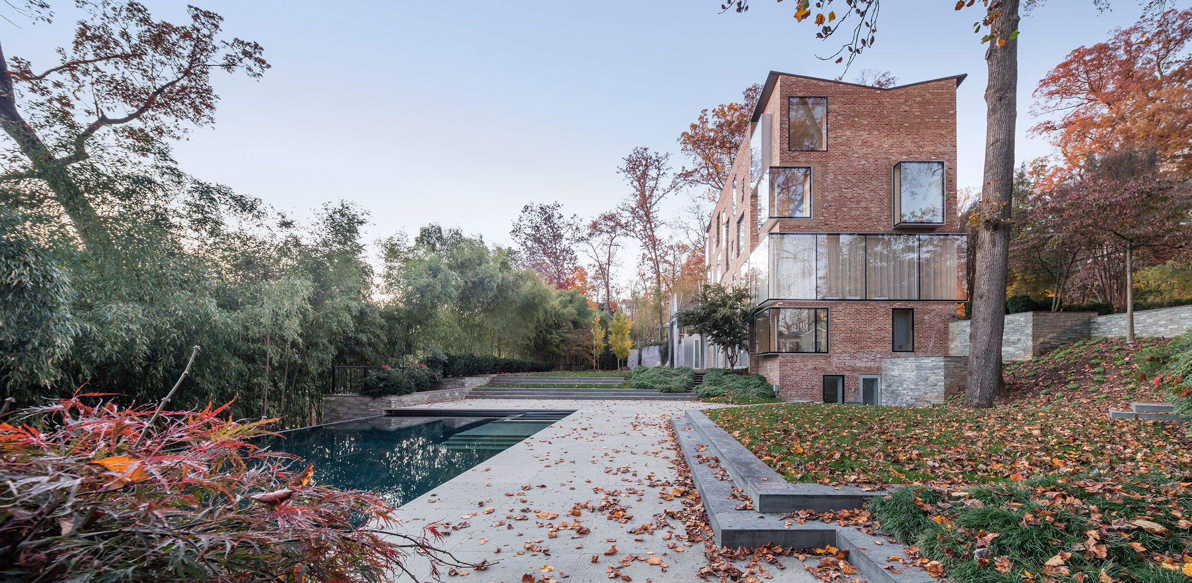 NADAAA overhauls brick Virginia house with ample glazing and a plywood interior