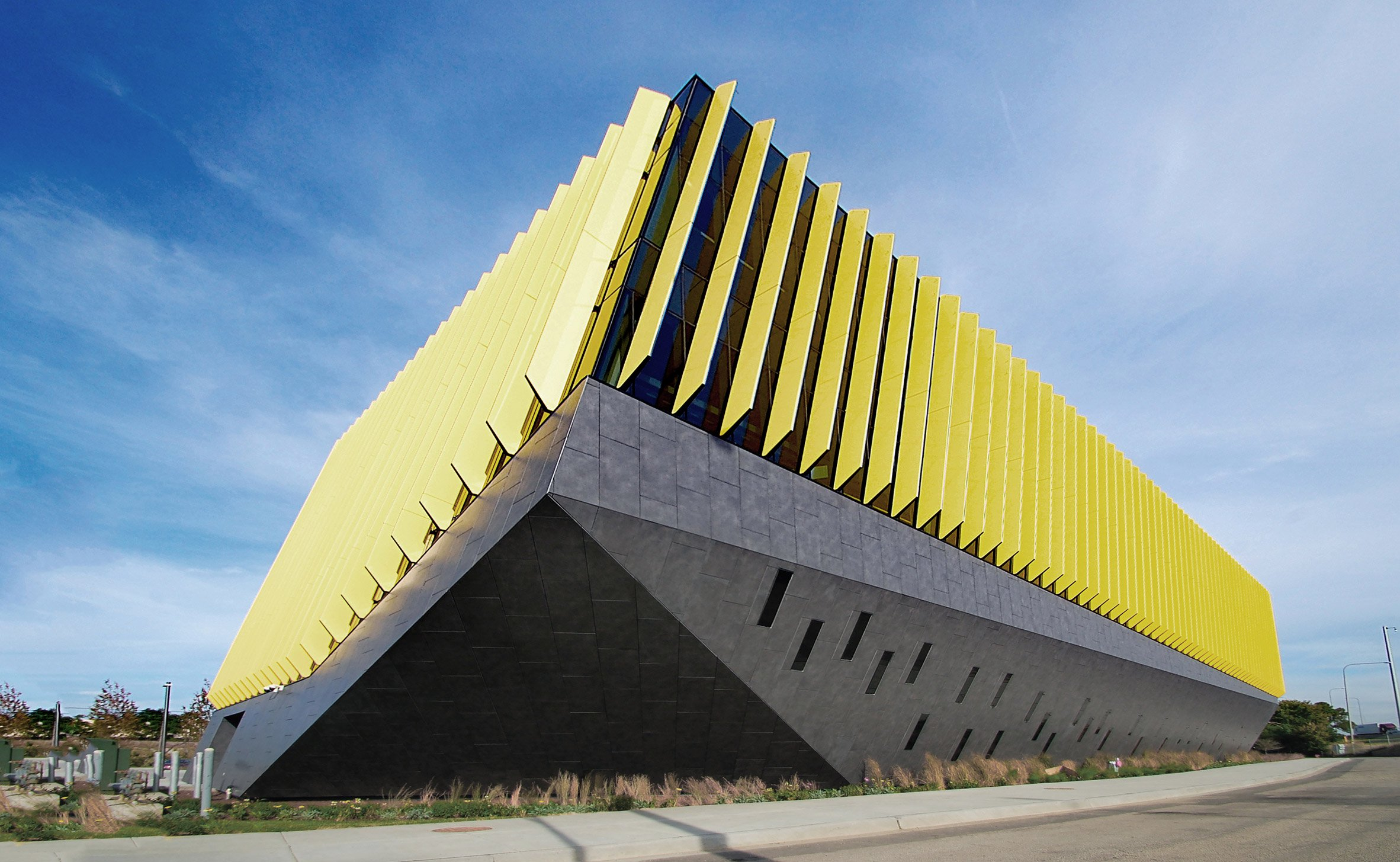 Blue and yellow fins wrap sculptural academic building in Chicago by JGMA