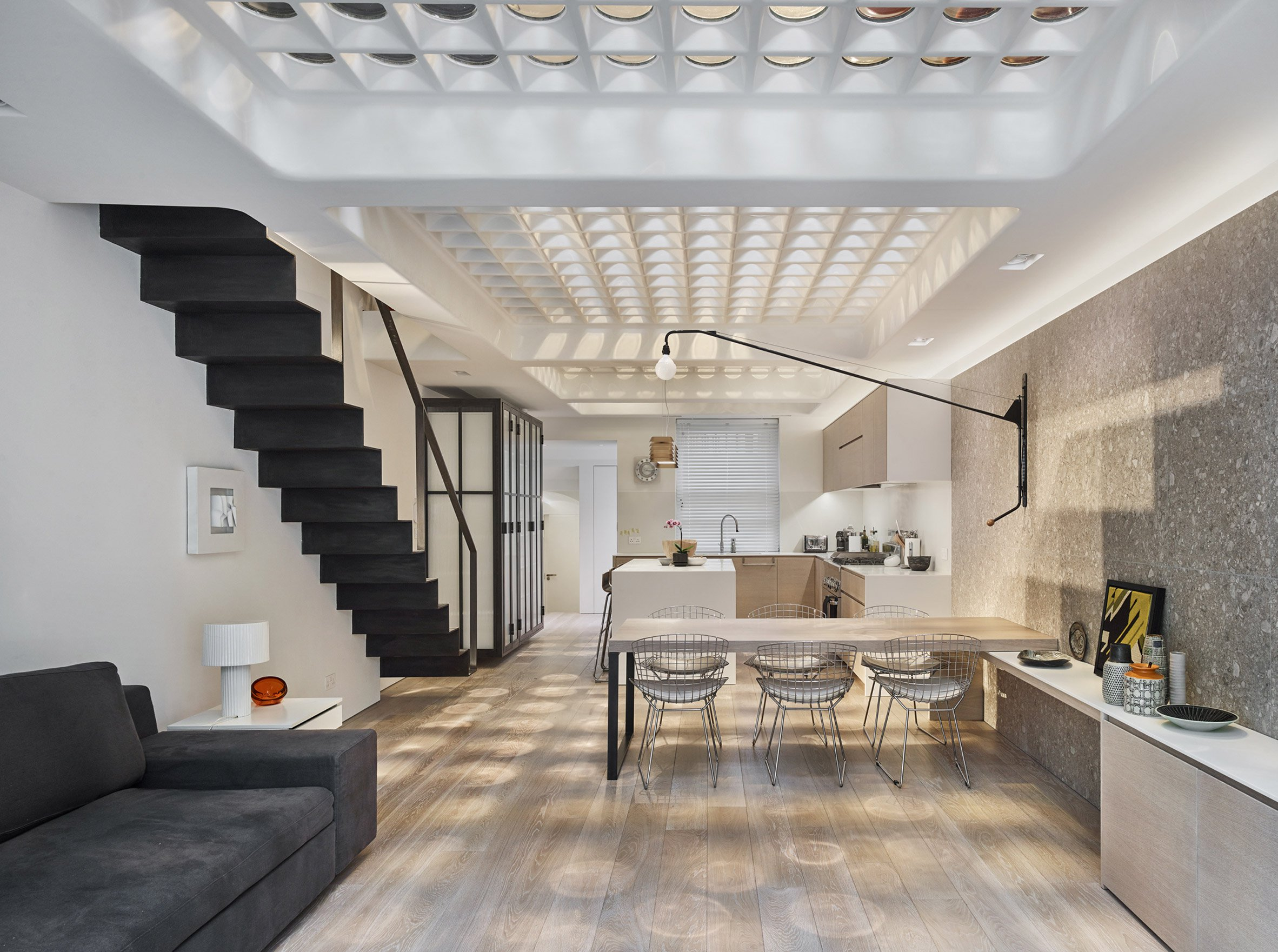 Perforated steel and pavement lights let the sun pierce London townhouse by Andy Martin Architecture