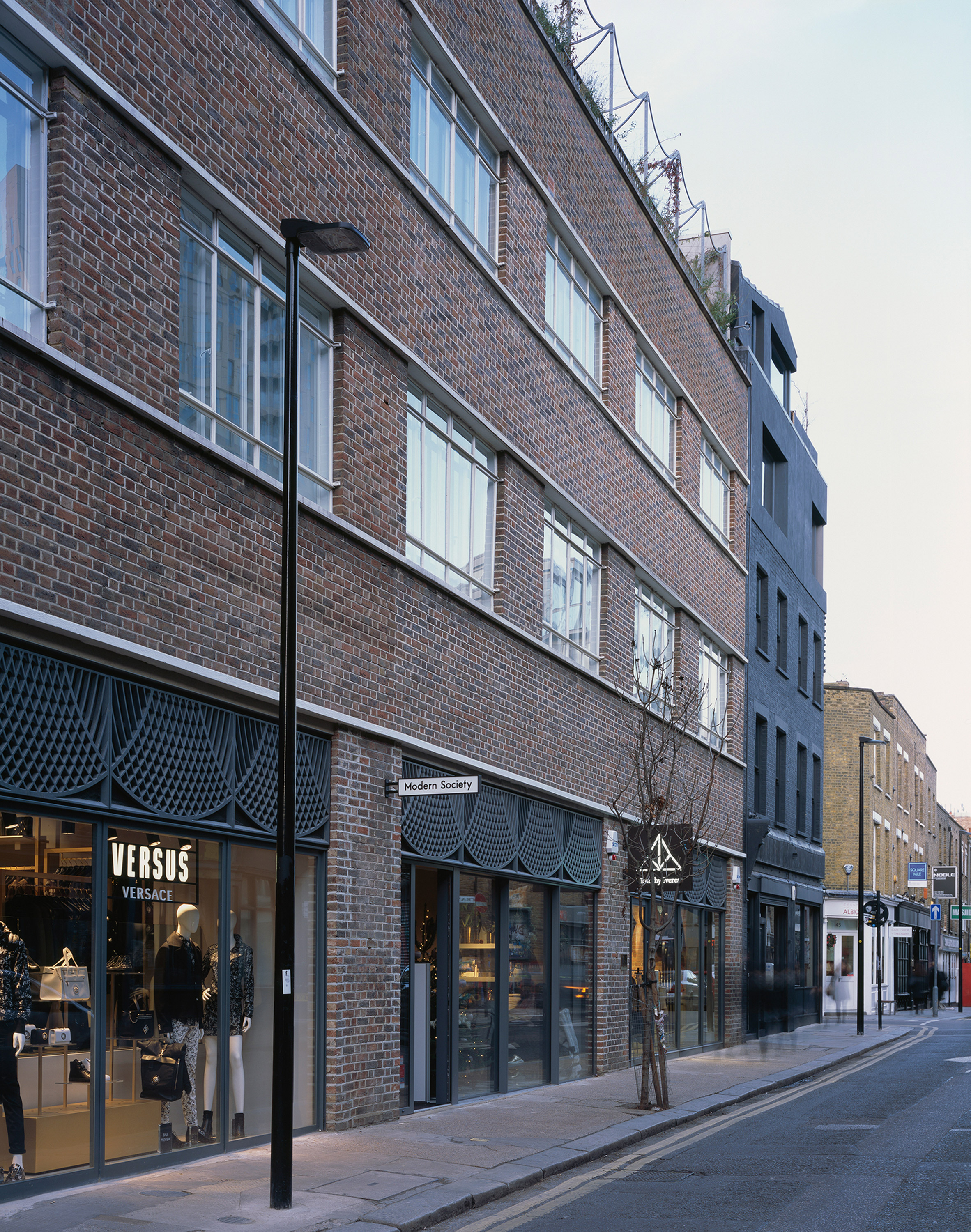 vPPR converts former Shoreditch warehouse into shops and flats linked by private walkway