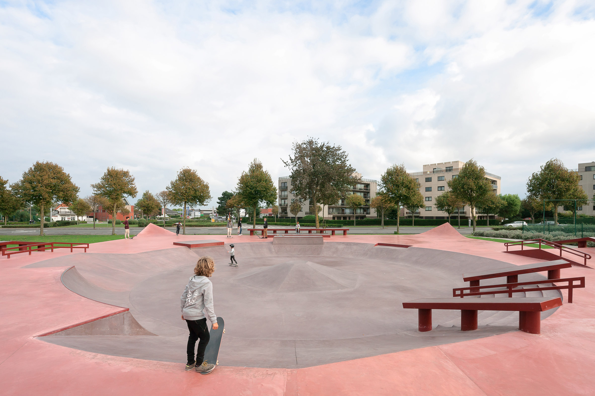 B-ILD & Constructo use shades of red concrete for skatepark on Belgian coast