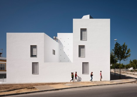 Kauh completes housing complex in Spain with large circular openings in the walls