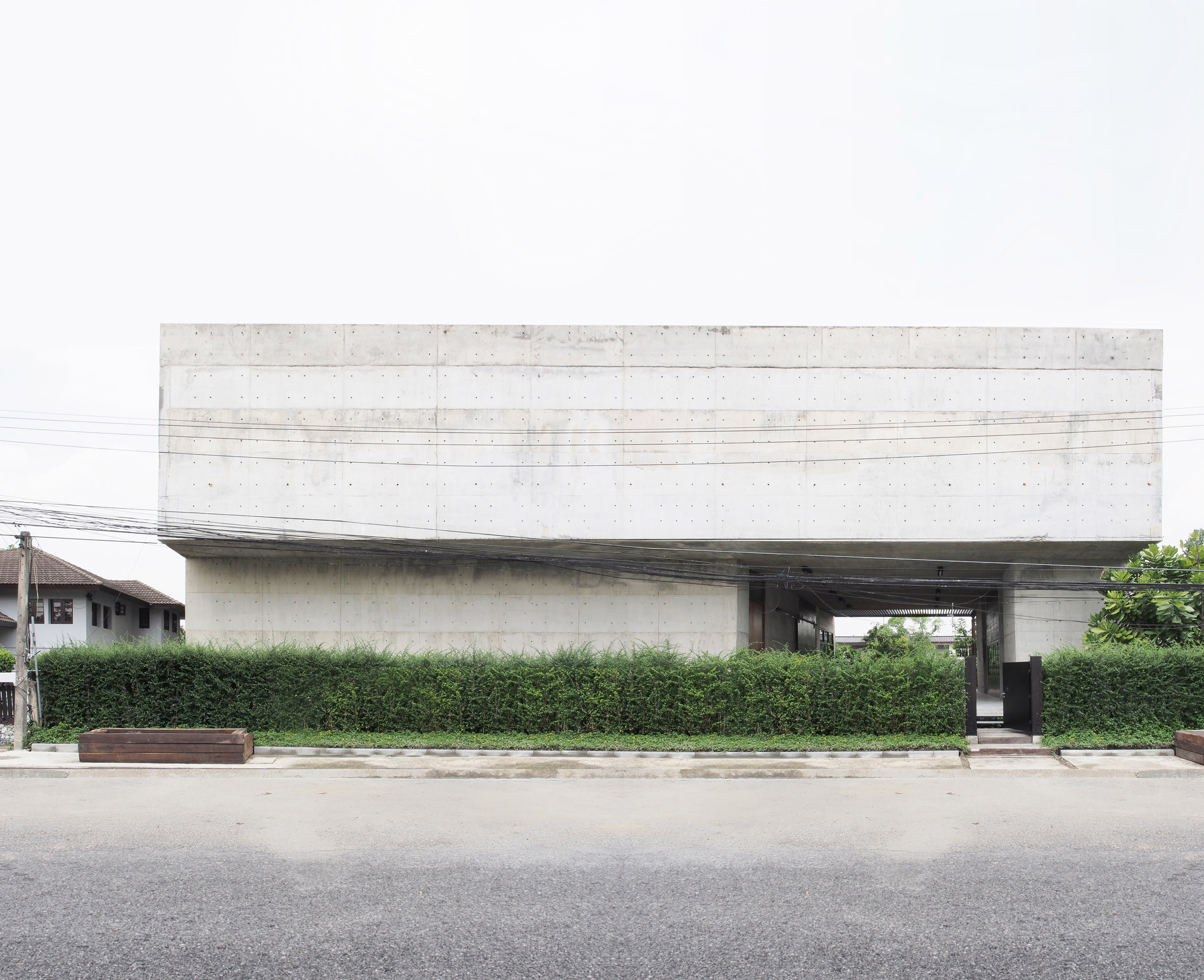 Concrete art gallery and studio in Bangkok features four-storey atrium