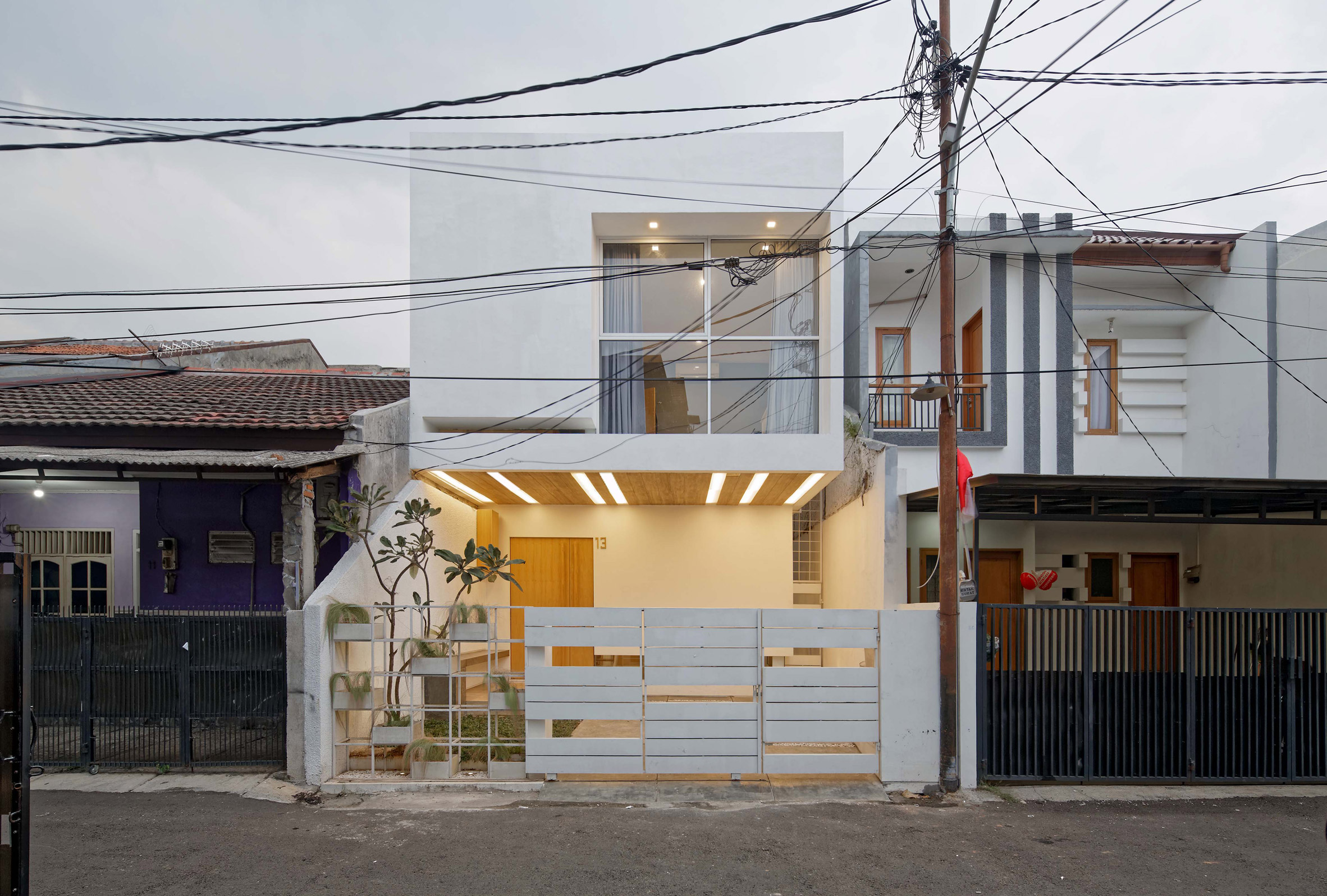 Multiple mezzanines are connected by an open stair in Delution Architect's Jakarta house