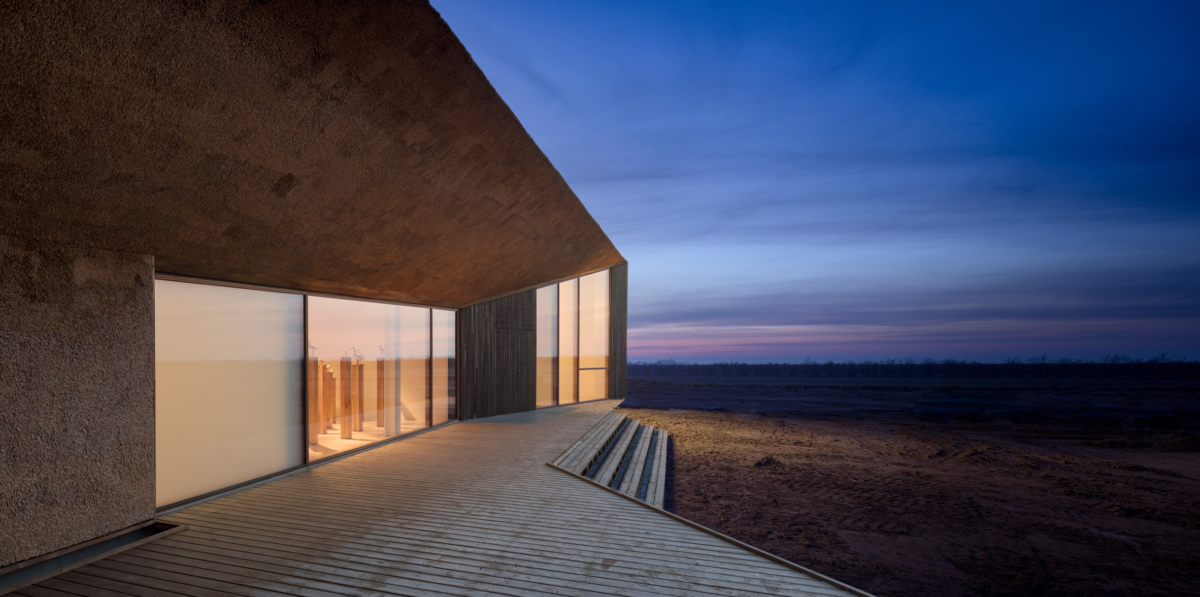 Dorte Mandrup adds thatched wing to Wadden Sea visitor centre in Denmark