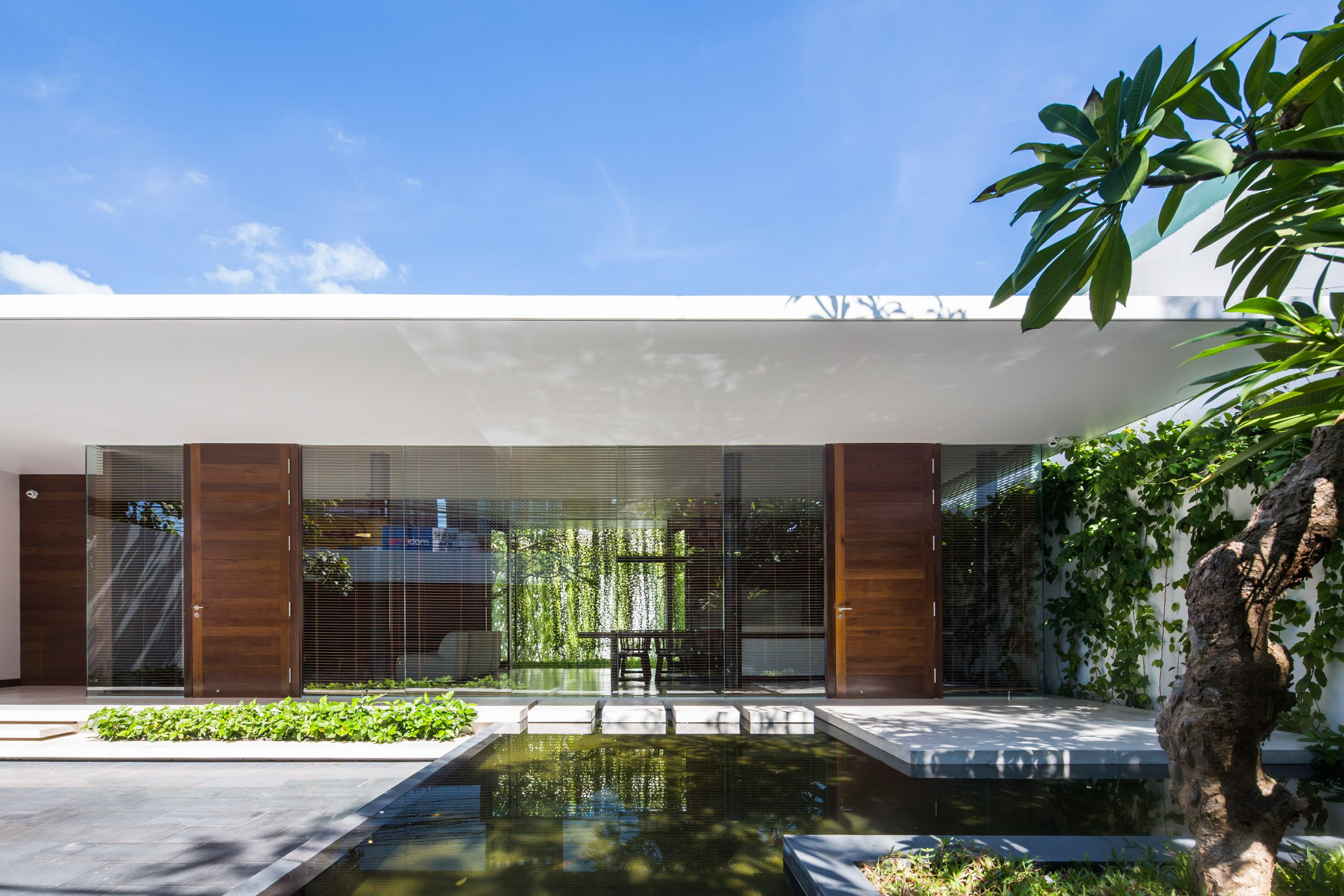 Mia Design Studio Envelopes Vietnam House In Plant Covered Walls And Courtyards Minimal Blogs
