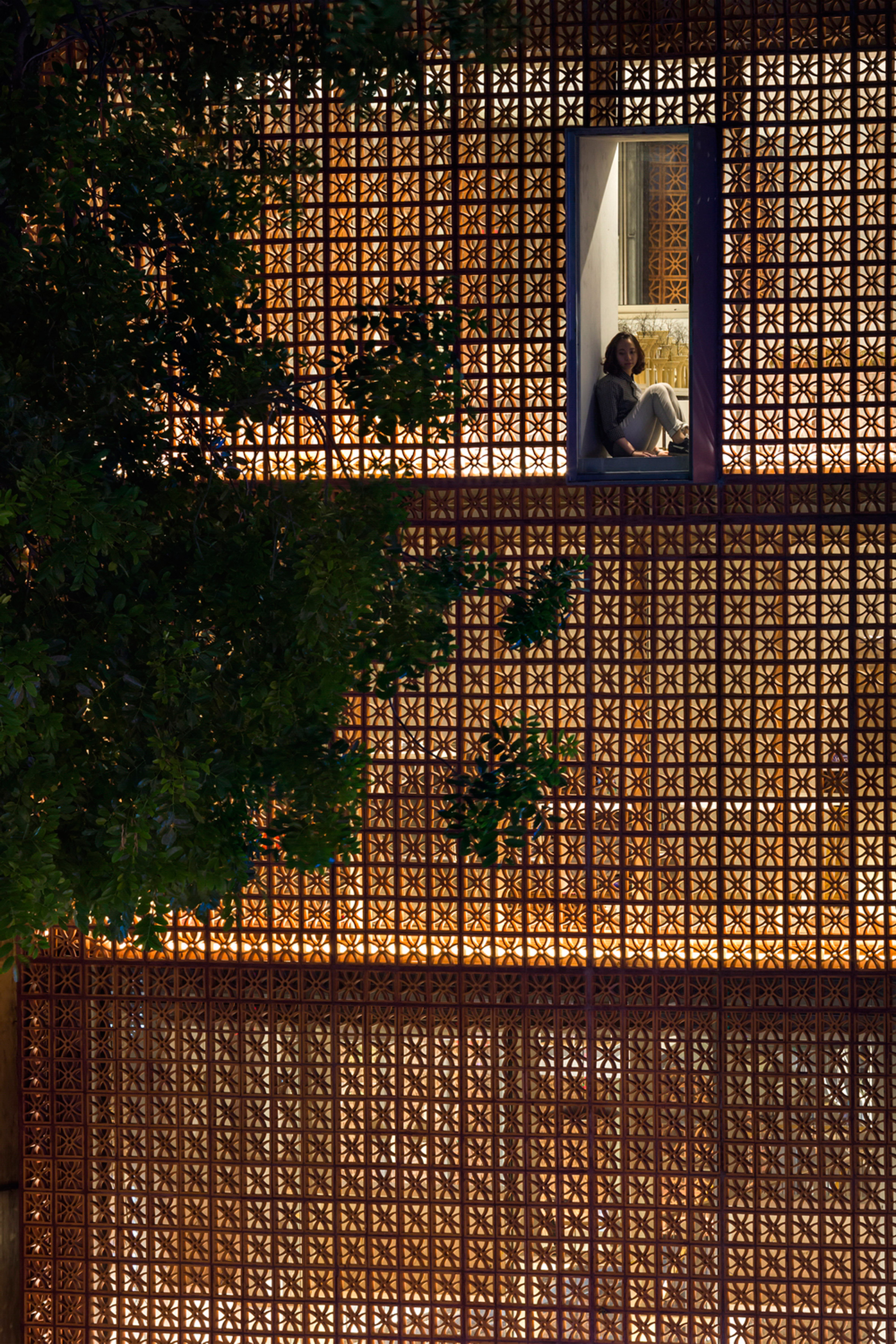 Vo Trong Nghia uses perforated blocks to create decorative facade for Panasonic showroom