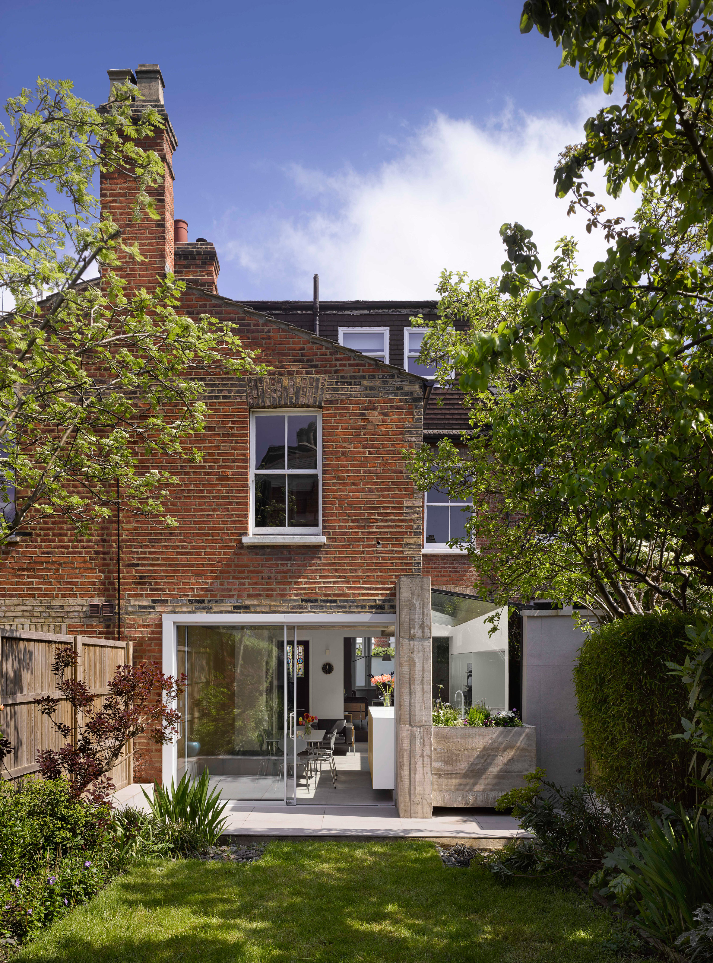 Paul Archer uses board-marked concrete and glass for London house extension