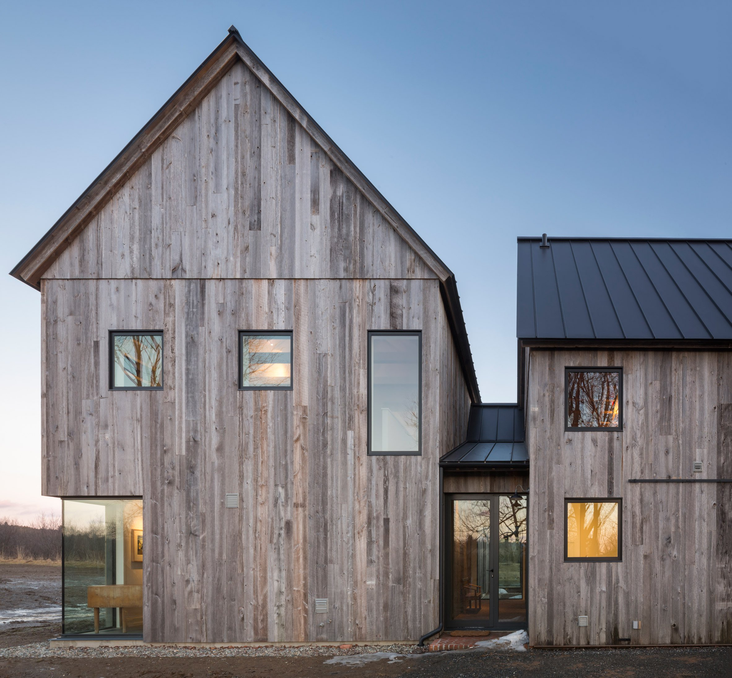 LAMAS builds contemporary Canadian farmhouse with reclaimed timber walls