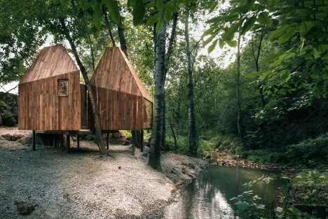 Wee Studio completes crowdfunded treehouses on the edge of a woodland stream