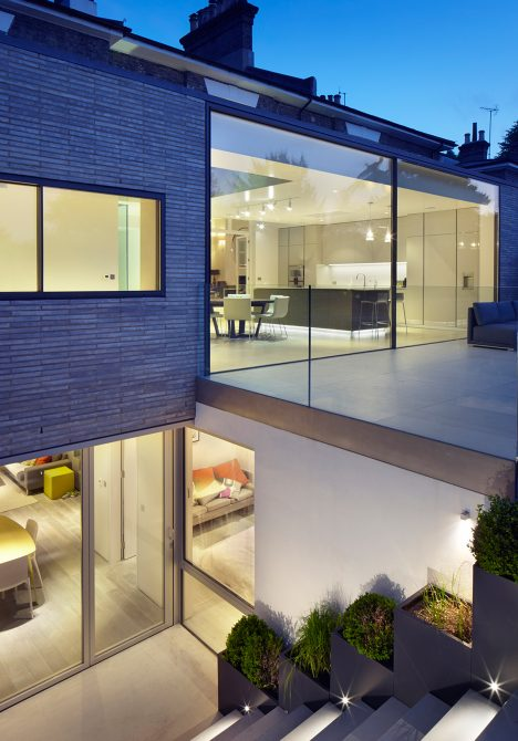 Studio Octopi adds glass-fronted extension to White Lodge house in London